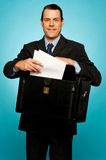 Male executive arranging paper works Royalty Free Stock Photo
