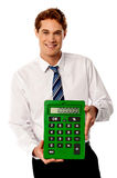 Male executive with big calculator. Stock Images