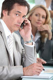 Male executive on cellphone Royalty Free Stock Photo