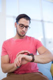 Male executive checking time on smartwatch Stock Images