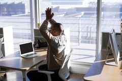 Male executive doing yoga. In office Stock Image