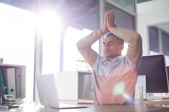 Male executive doing yoga. In office Stock Photos