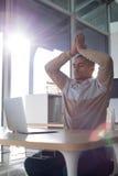 Male executive doing yoga Stock Photos