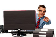 Male executive in glasses pointing at camera Stock Photography
