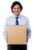 Male executive holding cardboard box Royalty Free Stock Photo