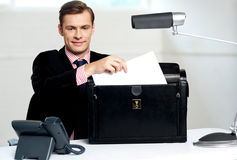 Male executive keeping documents safely Stock Photo
