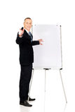 Male executive with marker pointing on someone Stock Image