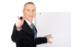 Male executive with marker pointing on someone Stock Photo