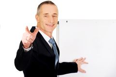 Male executive with marker pointing on someone Royalty Free Stock Image