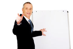 Male executive with marker pointing on someone Stock Photography