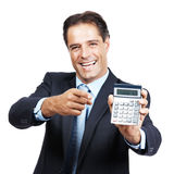 Male executive pointing at calculator Stock Photos