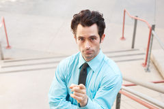 Male executive pointing a finger Stock Photography