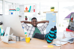 Male executive relaxing at his desk Stock Photo