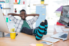 Male executive relaxing at his desk in office Royalty Free Stock Photos