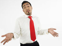 Male Executive Shrugging Off. Portrait of a male executive shrugging off against white background Stock Photos