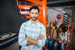 Male executive standing with arms crossed in office Royalty Free Stock Photos