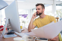 Male executive talking on mobile phone. In the office Stock Photos