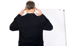 Male executive thinking about presentation Royalty Free Stock Photography