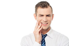 Male executive with toothache Stock Image