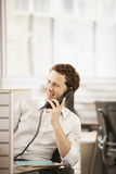 Male Executive Using Landline In Cubicle Stock Image