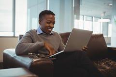 Male executive using laptop Royalty Free Stock Photos