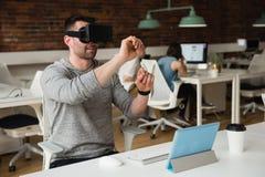 Male executive using virtual reality headset Stock Photography
