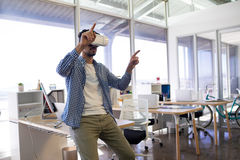 Male executive using virtual reality headset. In office Royalty Free Stock Image