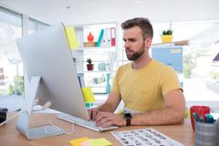 Male executive working on computer. In office Royalty Free Stock Photos