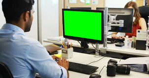 Male executive working on computer stock video footage
