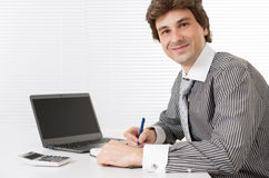 Male executive working on laptop computer Royalty Free Stock Photos
