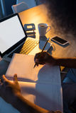 Male executive writing in diary at his desk Royalty Free Stock Images