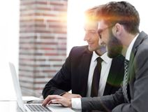 Male executives in office, looking at computer. Concept of teamwork royalty free stock photos