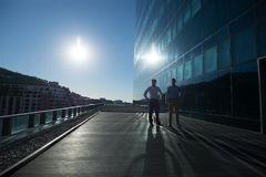 Male executives walking together in office premises Stock Photo
