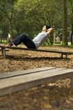 Male Exercising Abs at Park - vertical Royalty Free Stock Image