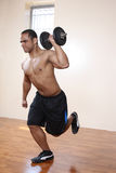 Male exercising, lifting dumbbell royalty free stock photography