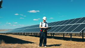 Male expert is observing a solar electric generating station