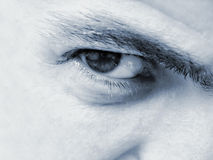 Male eye closeup. Scary expressive male hypnotic eye Stock Photography