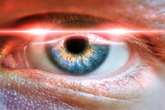 Male eye scanned for secure identifiation or concept for medicial iris correction. royalty free stock image