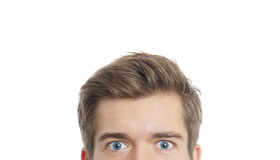 Male eyes staring. Upper part of a male face with staring eyes Stock Photography