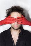 Male face with eyes closed red hands Stock Images