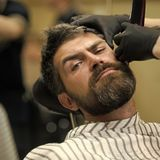 Male Face. Issues affecting boy. Fashion and beauty, innovation. Haircut of bearded man, archaism. Man cut long beard and mustache with trimmer razor. Barber Stock Photography