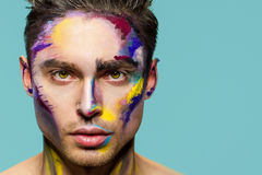 Male face, makeup art. Handsome caucasian man close up. The bold look Stock Image