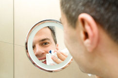Male face in mirror Stock Images