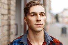 Male face outdoors. Portrait of a handsome man with a haircut. Male face outdoors. Portrait of a handsome man with a haircut Stock Photo