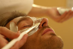 Male Facemask. A man receives a facemask treatment in the beautyfarm Royalty Free Stock Photo