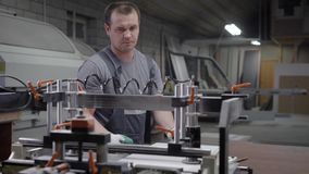 Factory worker man in overall standing near machine in plant room stock video footage