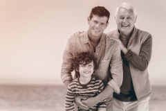 Male family members posing at the beach Stock Photography