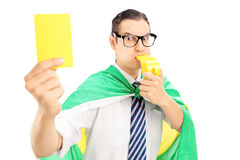 Male fan with flag of Holland holding a yellow card and blowing Royalty Free Stock Photos