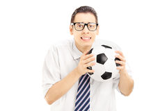 Male fan with tie and shirt holding a ball and waiting for a sco Stock Photo