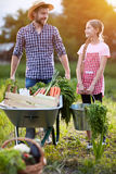 Male farmer with daughter returning from garden royalty free stock photos